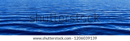 Deep blue gentle ocean waves panorama background