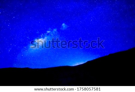 Deep blue night stars sky in mountains. Blue sky night stars view. Dark blue night sky with stars