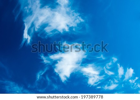 Deep blue sky with bright fluffy clouds