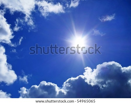 Deep blue sky with clouds and sunlight rays - stock photo