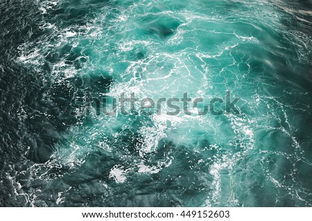 Deep blue stormy sea water surface with white foam and waves pattern, background photo texture #449152603