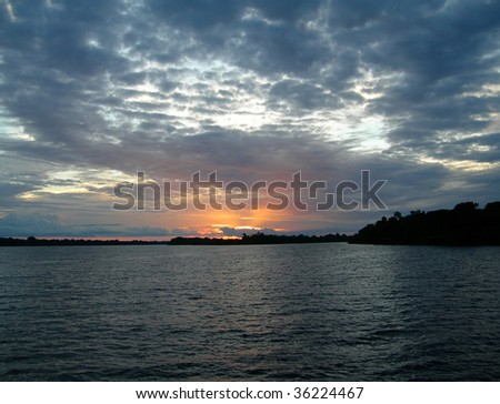 Deep blue sunset on the Rio Negro in the Amazon River basin, Brazil, South America