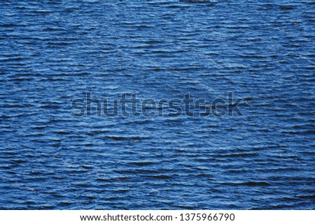Deep blue water with small waves as background, texture #1375966790