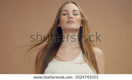 deep breathing caucasian woman with hair moved by air. Slow motion 60fps