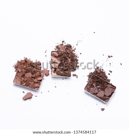 Deep brown crumbled eye shadow isolated on white background. #1374584117