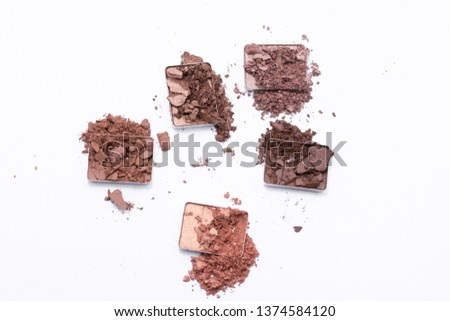 Deep brown crumbled eye shadow isolated on white background. #1374584120