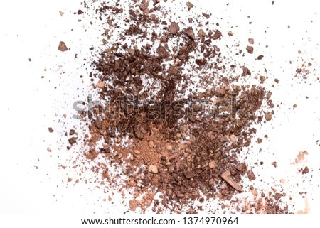 Deep brown crumbled eye shadow isolated on white background. #1374970964