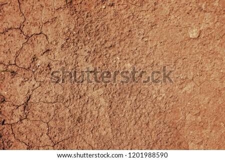 Deep brown dry soil #1201988590