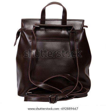 Deep brown leather backpack standing isolated on white background #692889667