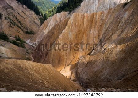 Deep brown mountain crevasse #1197546799
