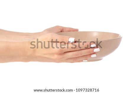 Deep brown soup plate in hand on white background isolation #1097328716