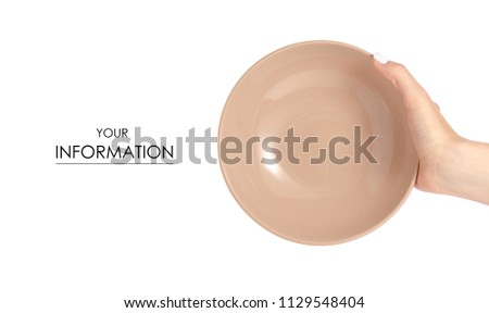 Deep brown soup plate in hand pattern on white background isolation #1129548404