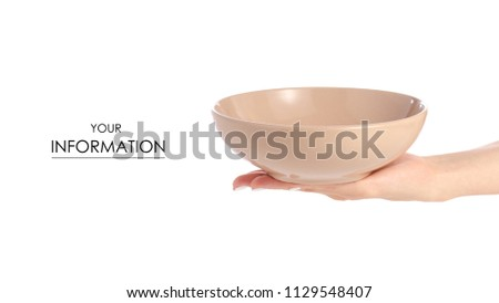 Deep brown soup plate in hand pattern on white background isolation #1129548407