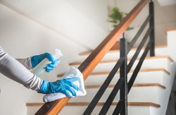 Deep cleaning for Coronavirus disease prevention. alcohol,disinfectant spray on Wipes of Banister in home for safety,infection of Covid-19 virus,contamination,bacteria that are frequently touched