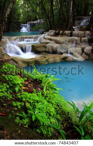 Deep forest waterfall, Erawan Waterfall, at National Park in Thailand
