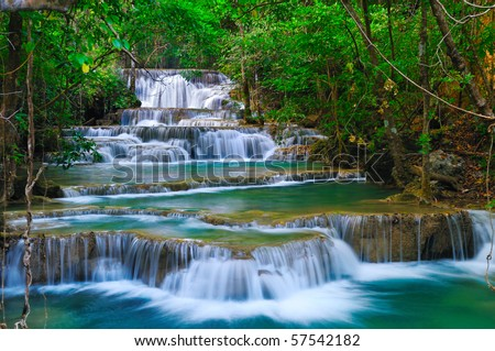 Deep forest waterfall in kanchanaburi thailand stock for Definicion de pintura mural