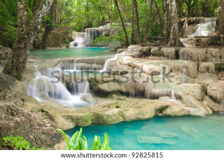 Deep forest waterfall in Kanjanaburi Thailand (Erawan waterfall) - stock photo