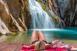 Deep forest Waterfall - Pebbles rocks underwater below Alara Ucansu waterfall with surface in shallow water - Antalya, Turkey
