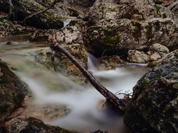 Deep forest winter creek waterfall. Pure nature landscape. in mountain European forest.