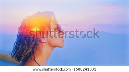 Deep fresh air calm peace life, teen girl dream, soul body concept. Double exposure portrait of a cute happy woman head face side portrait with sunglasses, look at sun sea nature sunrise sunset in sky Foto stock ©
