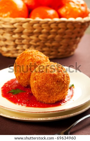 Deep fried balls of arborio rice stuffed with mozzarella cheese