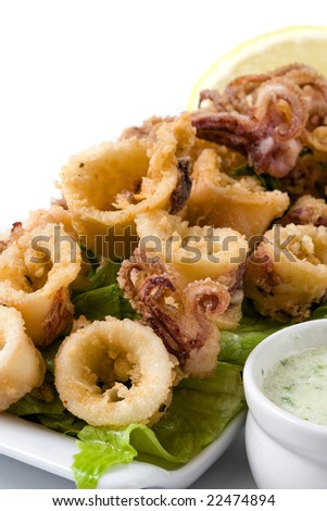 deep fried calamari with letucce and sauce