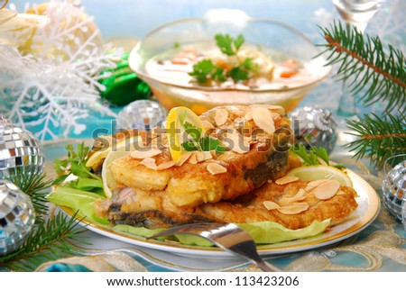 deep-fried carp steaks with almond flakes for traditional polish christmas eve