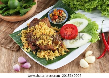 deep fried chicken with crispy called kremesan also known as ayam goreng kremes Stock fotó ©