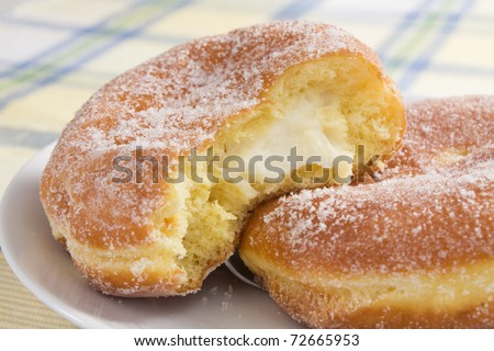 Deep-fried doughnuts (paczki) filled with cream cheese are eaten on Fat Tuesday before Lent.