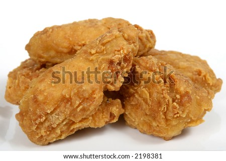 Deep fried fast food, spring chicken in golden lemon batter macro close up isolated on black white