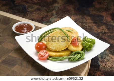 Deep Fried Fish Cake, dressing with tomato & vegetable. Delicious, Yummy!!