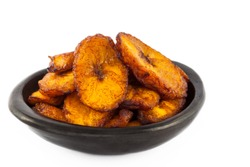 Deep fried ripe plantain slices isolated in white background