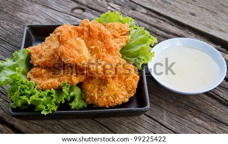 deep fried shrimp meat ball with sweet sauce on wooden table