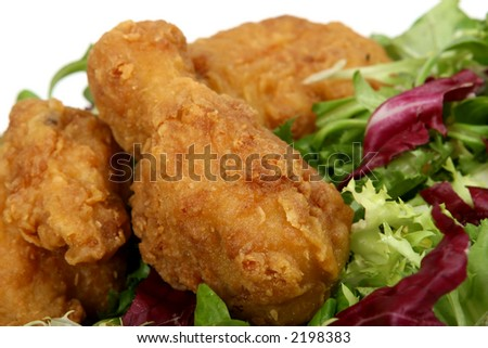 Deep fried spring chicken in golden lemon batter with salad - stock photo