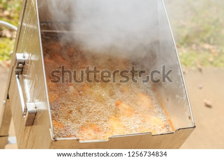 Deep Fryer:  Deep fryer in use and steaming or smoking hot. #1256734834