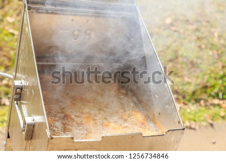 Deep Fryer:  Deep fryer in use and steaming or smoking hot. #1256734846