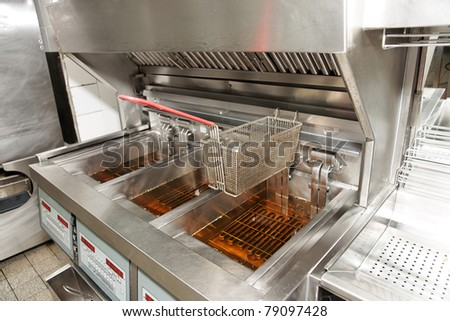 Deep fryer with oil on restaurant kitchen