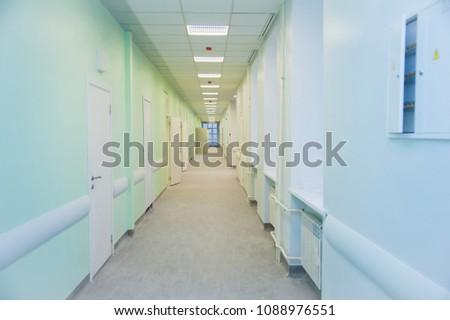 Deep hospital corridor, detail of a corridor in a hospital #1088976551