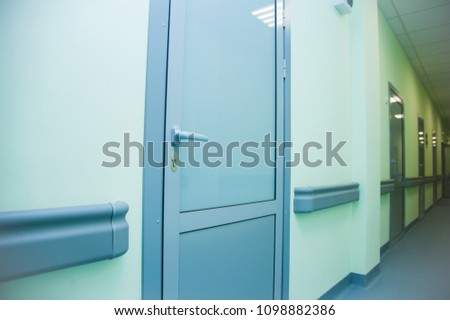 Deep hospital corridor, detail of a corridor in a hospital #1098882386