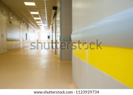 Deep hospital corridor, detail of a corridor in a hospital #1123929734