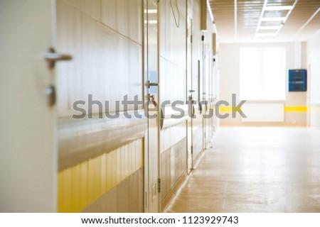 Deep hospital corridor, detail of a corridor in a hospital #1123929743