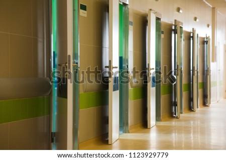Deep hospital corridor, detail of a corridor in a hospital #1123929779