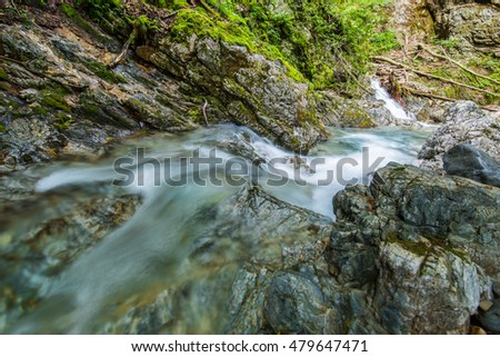 Deep in the mountains of the mountain stream. #479647471