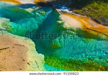 Deep inside blue green geyser in Yellowstone National Park