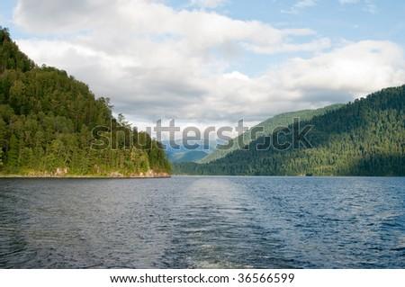 deep lake between mountains, summer. - stock photo