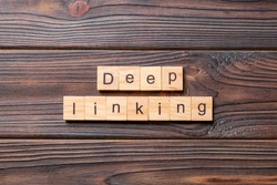 Deep Linking word written on wood block. Deep Linking text on cement table for your desing, concept.