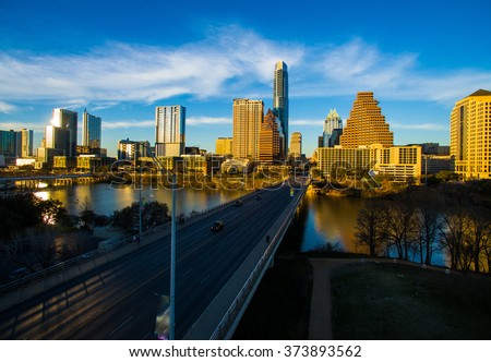Deep Perspective Austin Texas South Congress Avenue Aerial Fly Hover Shot looking at State Capital Building. Sunset Glow hits the downtown Skyline Cityscape a dramatic Urban ATX shot.