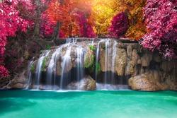 Deep rain forest jungle waterfall at Erawan waterfall National Park Kanchanaburi in Thailand