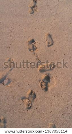 deep sea deep breath and kid's footprints on the sand #1389053114