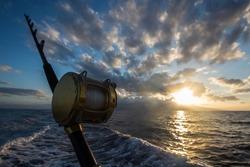 Deep Sea Fishing Reel on a boat during sunrise